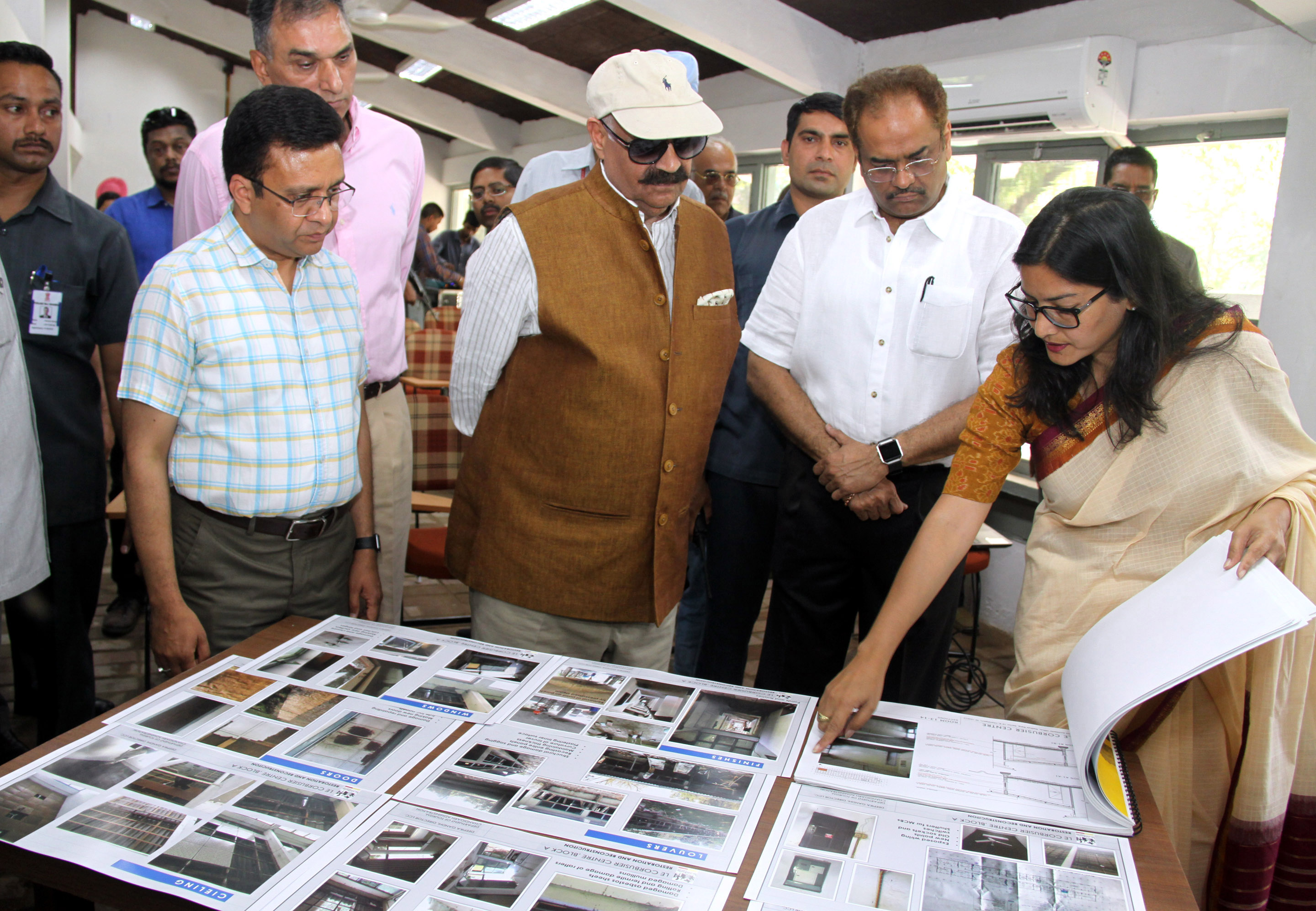 """The Governor of Punjab and Administrator, UT, Chandigarh, Shri V.P. Singh Badnore, the Adviser to the Administrator, UT, Chandigarh, Shri Parimal Rai alongwith senior officers taking a round of the  """"Open Hand Art Studio"""" after inaugurating on the occasion of 122nd Birth Anniversary of Pierre Jeanneret at Le Corbusier Centre, Sector-19, Chandigarh on Tuesday, April 17, 2018."""