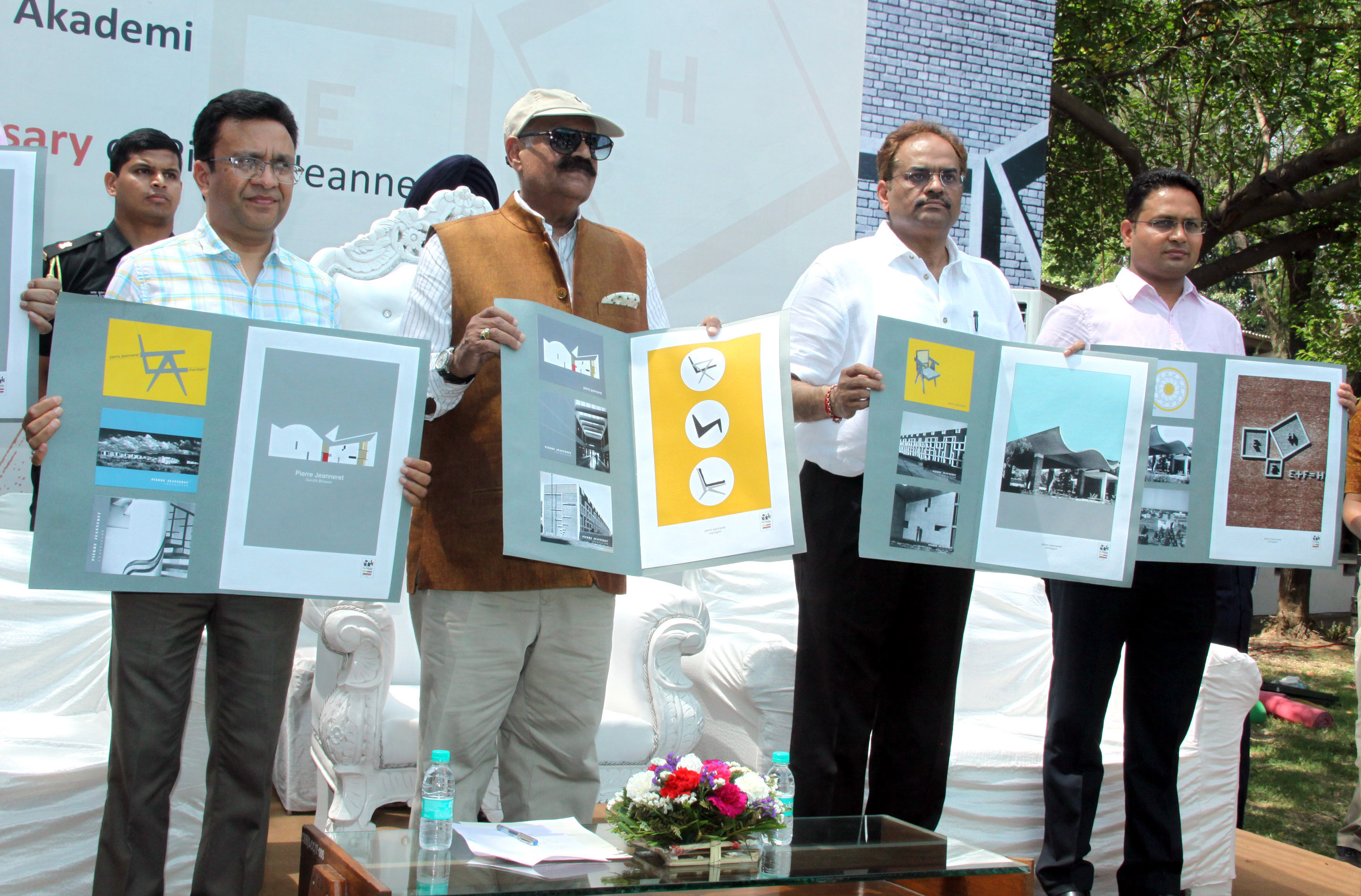 """The Governor of Punjab and Administrator, UT, Chandigarh, Shri V.P. Singh Badnore, the Adviser to the Administrator, UT, Chandigarh, Shri Parimal Rai alongwith senior officers releasing """"Souvenir based on the works of Jeanneret"""" on the occasion of 122nd Birth Anniversary of Pierre Jeanneret at Le Corbusier Centre, Sector-19, Chandigarh on Tuesday, April 17, 2018."""
