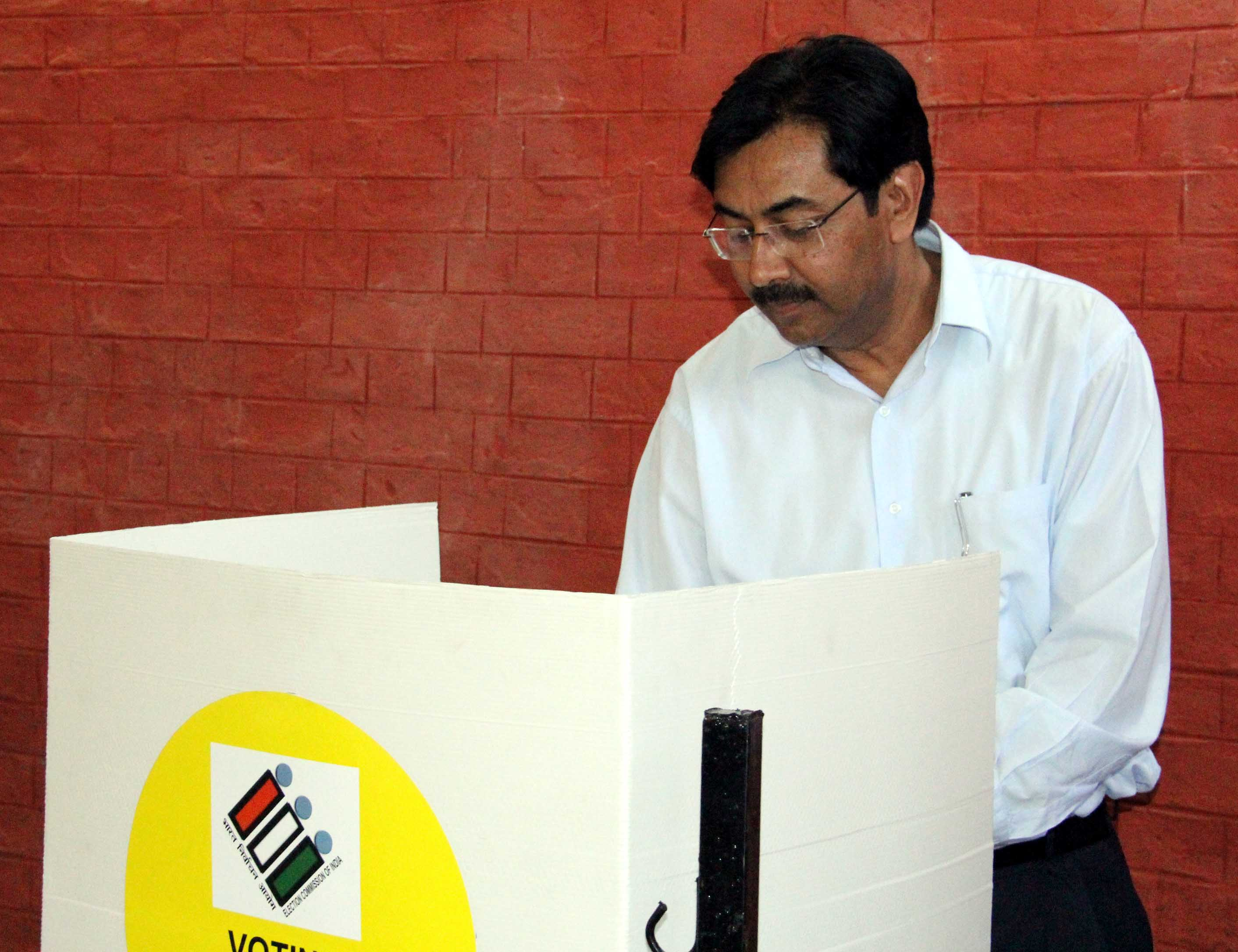 UT Home Secretary-Cum-Chief Electoral Officer, Mr. Anil Kumar casting his vote for General Elections to Lok Sabha-2014 of Chandigarh Parliamentary Constituency at polling booth Sector-16, Chandigarh on Thursday, April 10, 2014.