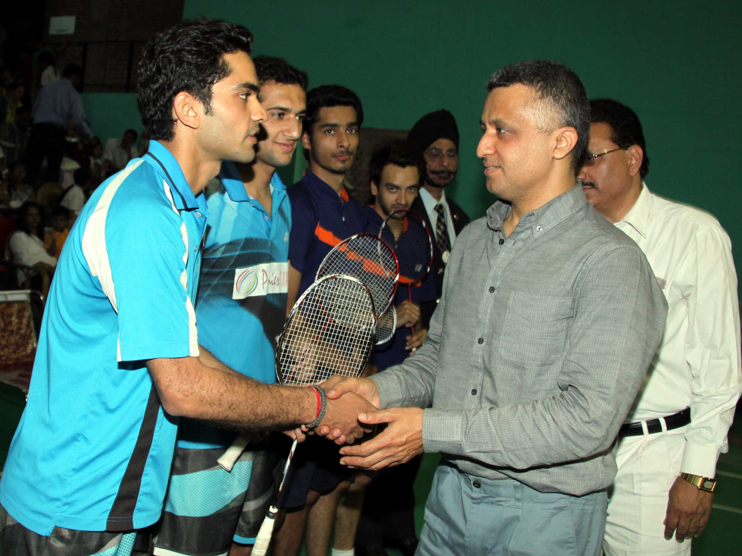 UT Finance-cum-Sports Secretary, Mr. Sarvjit Singh being introduced with the players at the Opening Ceremony of Tricity Li-ning Junior/Sub Junior Talent Hunt Badminton Tournament-2014 at Sports Stadium, Sector-42, Chandigarh on Wednesday, April 16, 2014.