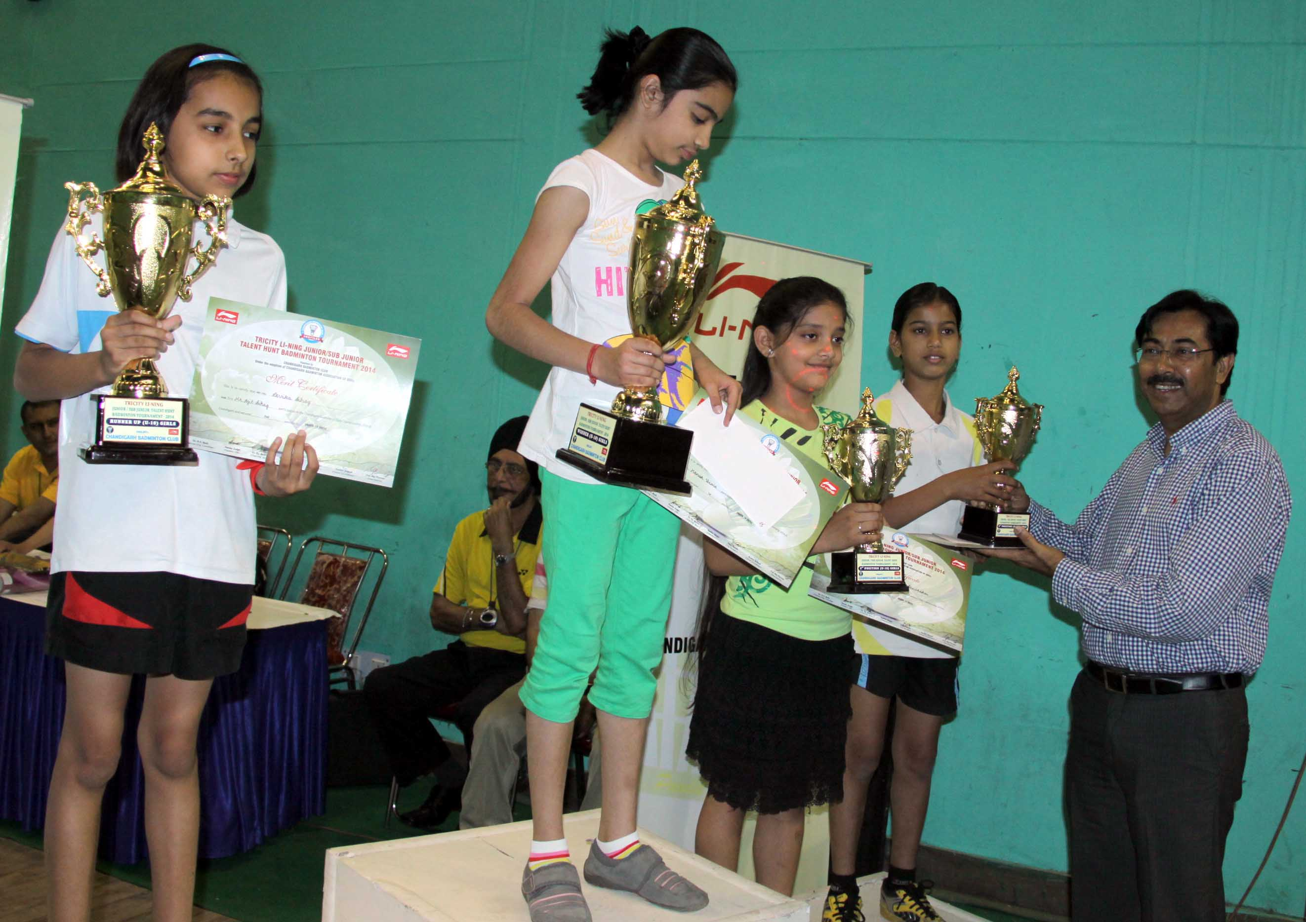 UT Home Secretary, Mr. Anil Kumar distributing prizes to the winners at the Closing Ceremony of Tricity Li-ning Junior/Sub Junior Talent Hunt Badminton Tournament-2014 at Sports Stadium, Sector-42, Chandigarh on Sunday, April 20, 2014.