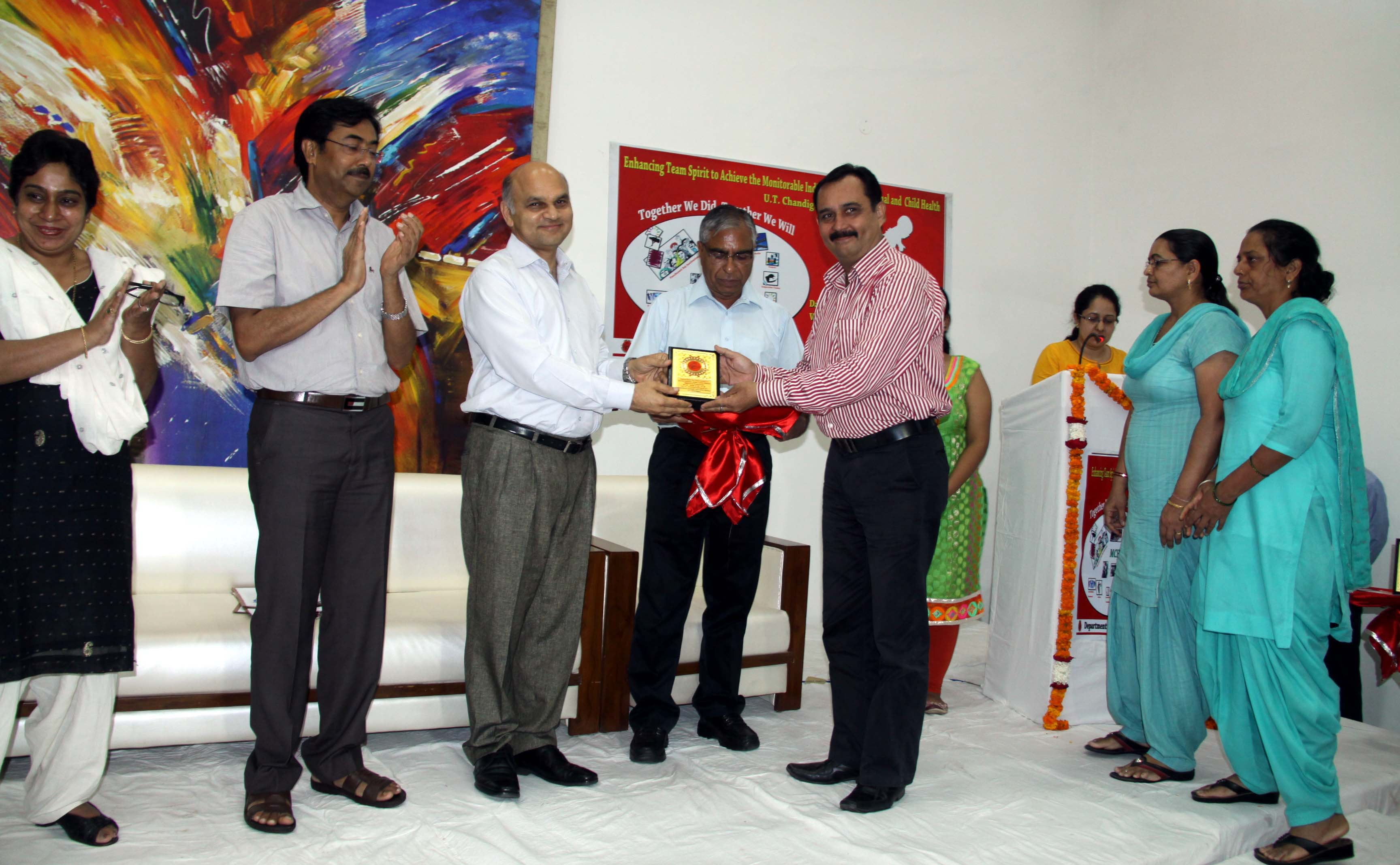The Adviser to the Administrator, UT, Chandigarh, Mr. K.K. Sharma honoring the teams, Stakeholders to improve the  Monitorable Indicators under RMNCH+A through the institutionalized good practices in U.T. Chandigarh for the year 2013-14 in the Felicitation Function at UT State Guest House, Chandigarh on Monday, July 21, 2014.