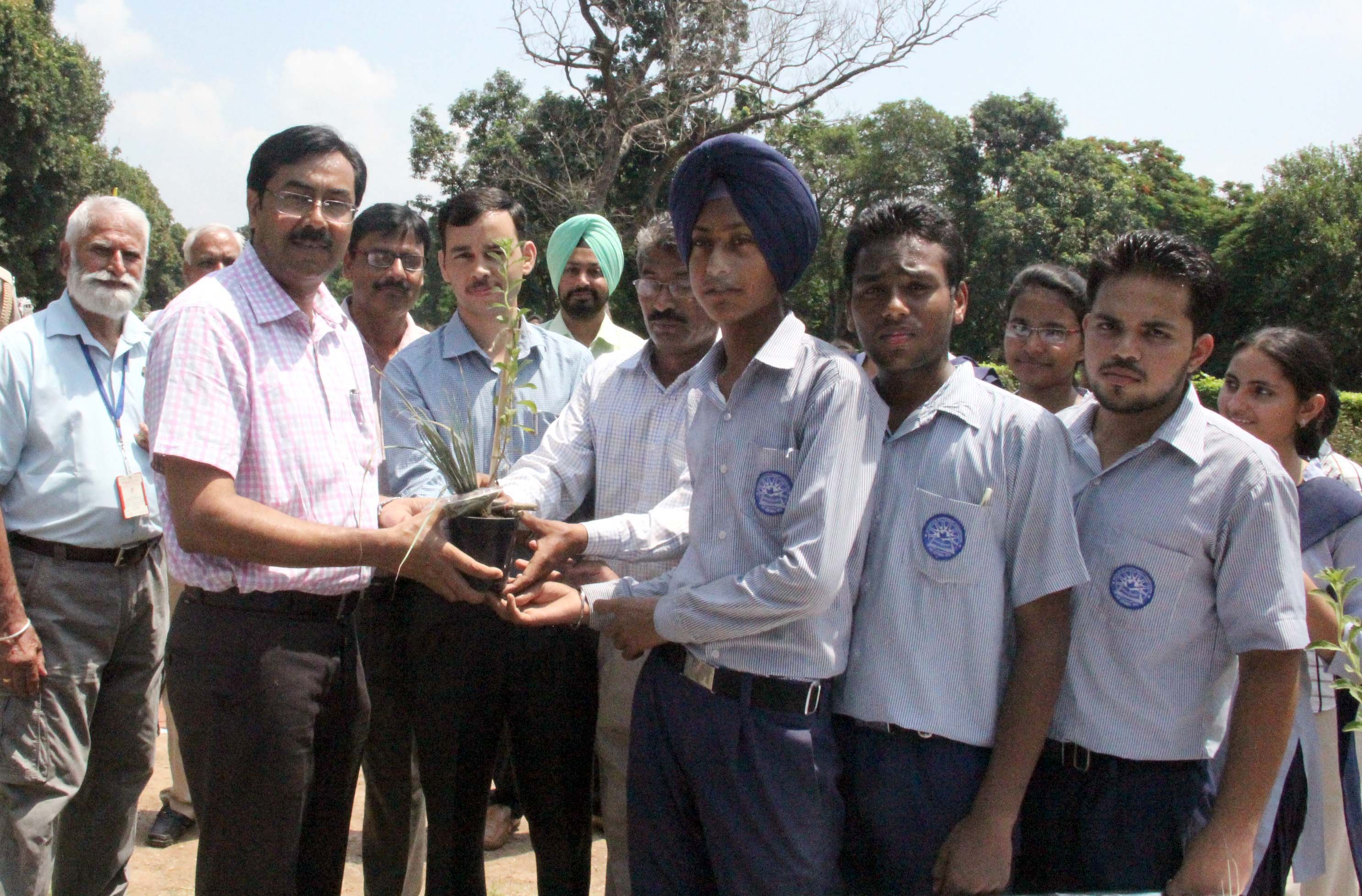 UT Home Secretary, Mr. Anil Kumar distributing sapling plants to the school children on the celebration of HERBAL DAY -2014 at Rose Nursery, Sector-23, Chandigarh on Wednesday, July 30, 2014.