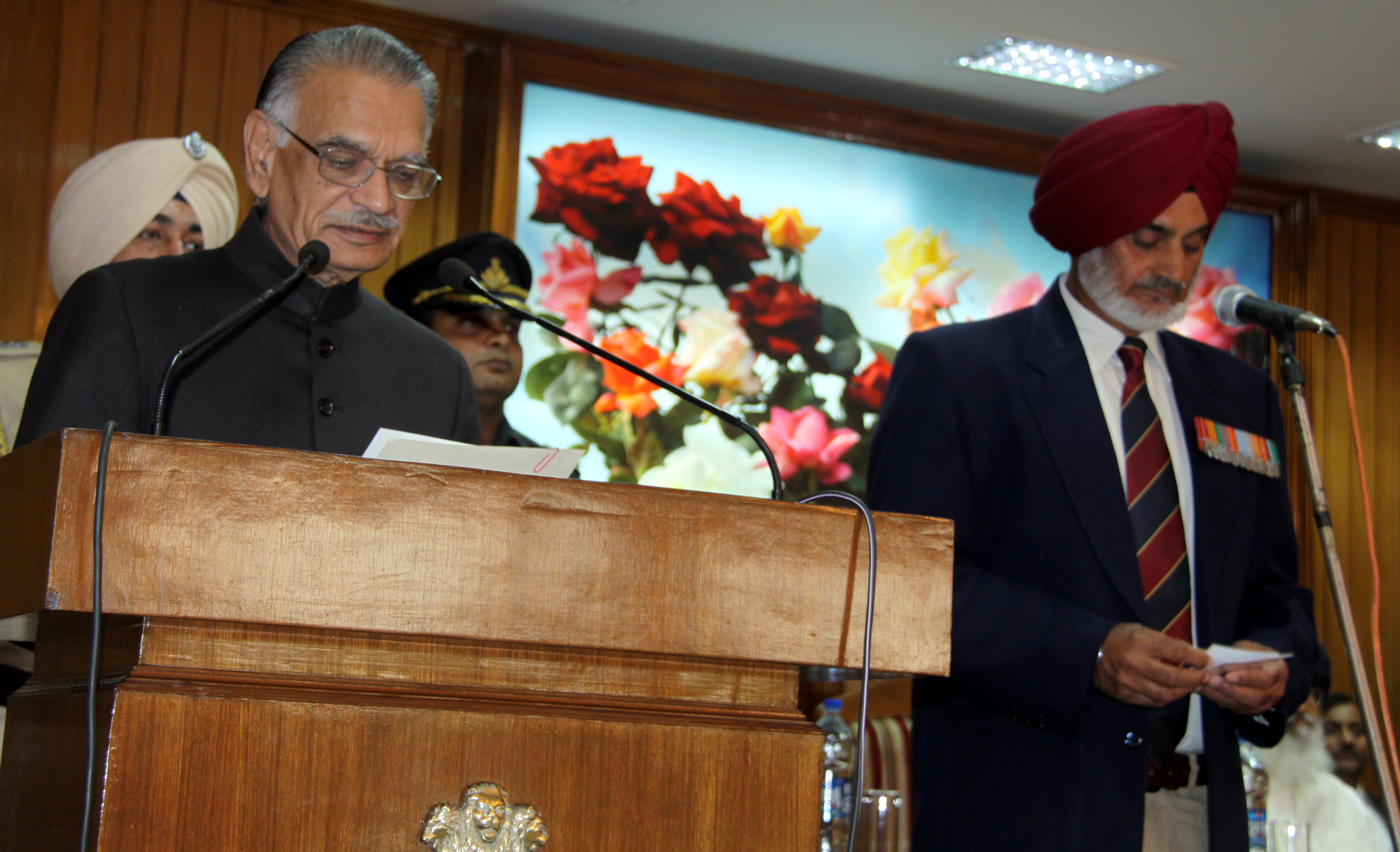 The Punjab Governor and Administrator, Union Territory, Chandigarh, Mr. Shivraj V. Patil administering the oath of office, secrecy and allegiance to Constitution of India to the newly appointed Chairman of the Punjab Public Service Commission (PPSC) Lt. Gen. (Retd.) Tejwant Singh Gill at Punjab Raj Bhavan Chandigarh on 02.09.2014.
