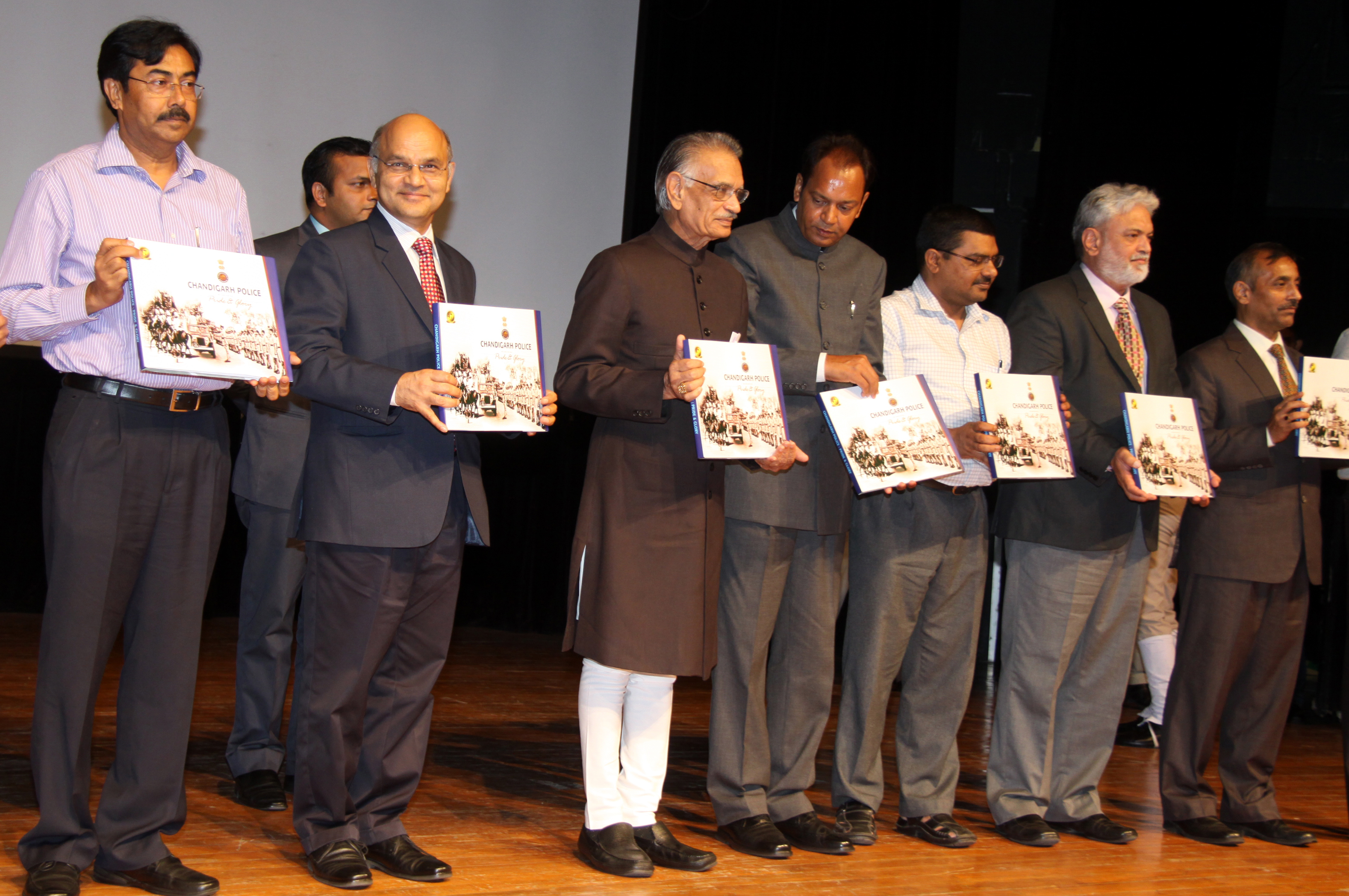 THE PUNJAB GOVERNOR AND ADMINISTRATOR, UT CHANDIGARH, MR SHIVRAJ V. PATIL RELEASING COFFEE TABLE BOOK OF CHANDIGARH POLICE AT TAGORE THEATRE CHANDIGARH ON 02.09.2014. OTHER SENIOR OFFICERS ARE ALSO SEEN IN THE PICTURE.