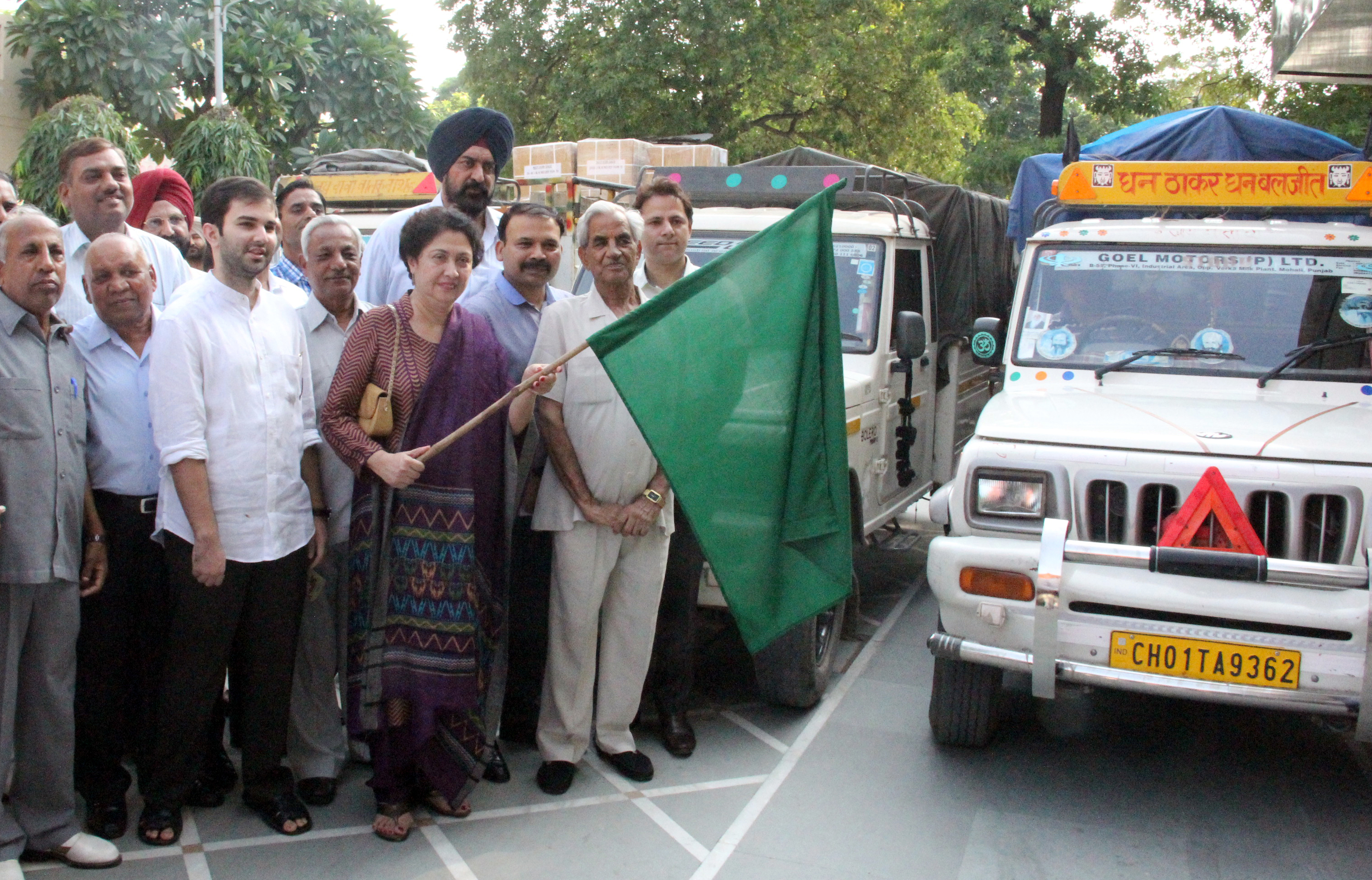 Mrs. Ninette Vas Sharma, Vice President of Indian Red Cross Society, Chandigarh w/o Mr. K.K. Sharma, Adviser to the Administrator, UT, Chandigarh flagging off three trucks containing assistance for flood effected persons in Jammu and Kashmir at Aggarsain Bhawan, Sector-30, Chandigarh on Thursday, September 18, 2014.