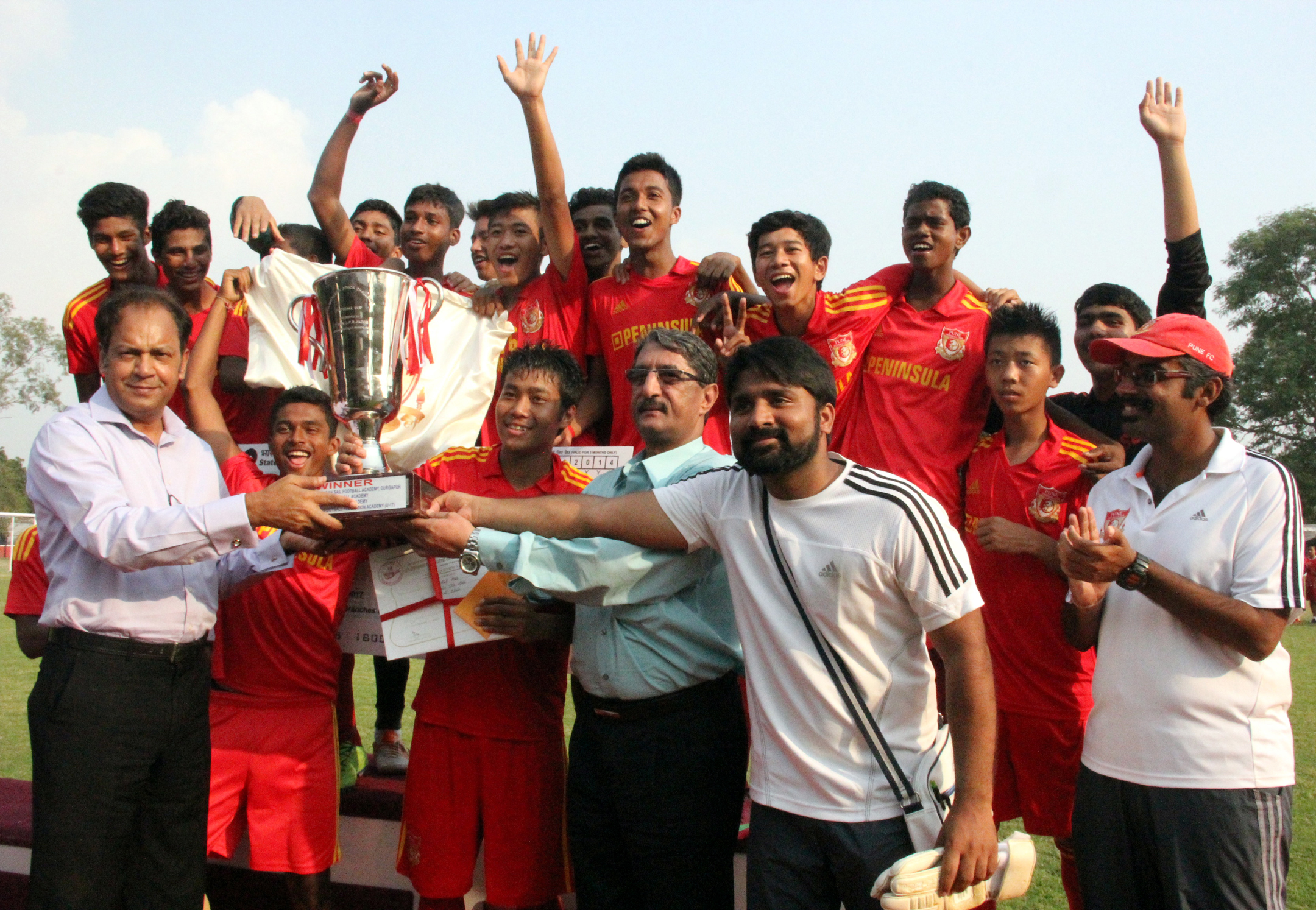 Mr. Rajender P Upadhyay,IGP, UT,  Chandigarh giving away winner�s trophy to the team of Pune Football Club at the closing ceremony of 12th Administrator�s Challenge Cup (U-17 Boys) All India Football Tournament-2014 at Football Ground, Sector-17, Chandigarh on Tuesday, September 30, 2014.