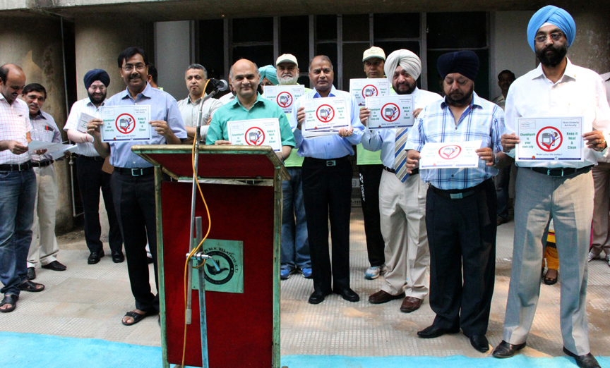 The Adviser to the Administrator, UT, Chandigarh, Mr. K.K. Sharma, UT Home Secretary, Mr. Anil Kumar and other officers releasing a Poster regarding Swachh Bharat Campaign at UT Secretariat, Chandigarh on Thursday, October 02, 2014.