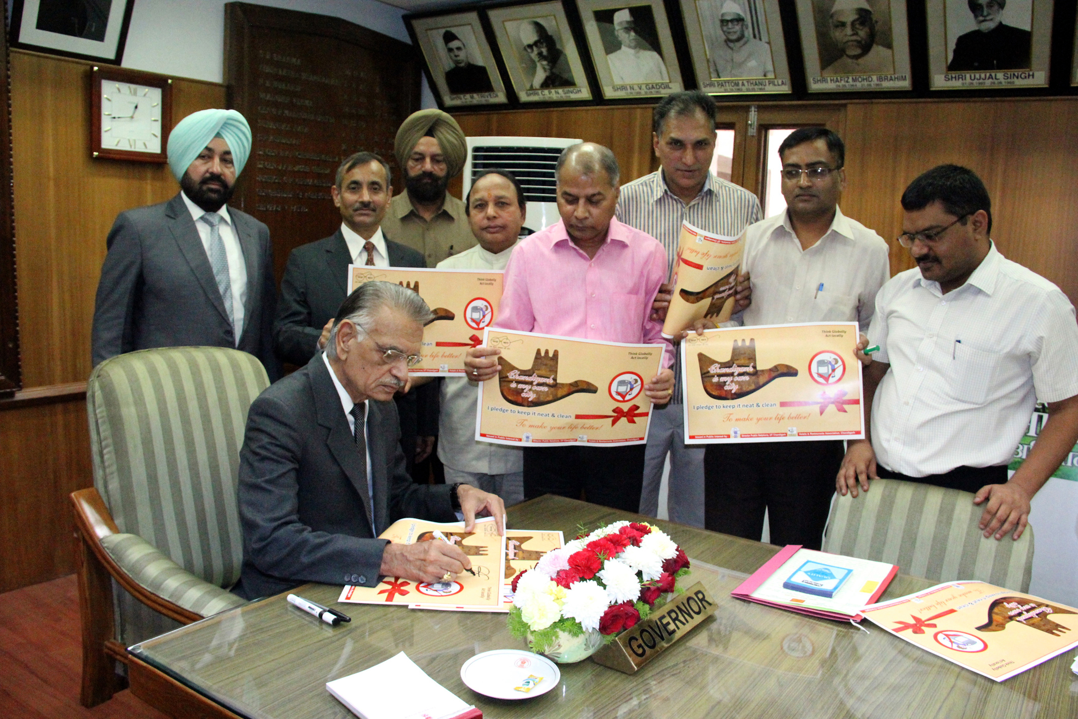 The Punjab Governor and Administrator, U.T., Chandigarh, Sh. Shivraj V. Patil  putting his signatures on the poster perpared by Director Public Relations in assocation with the Hotel & Restaurant Asscociation Chandigarh to mark the launching of signature campaign in the City to pledge to keep the city neat and clean at Punjab Raj Bhavan on 15-10-2014