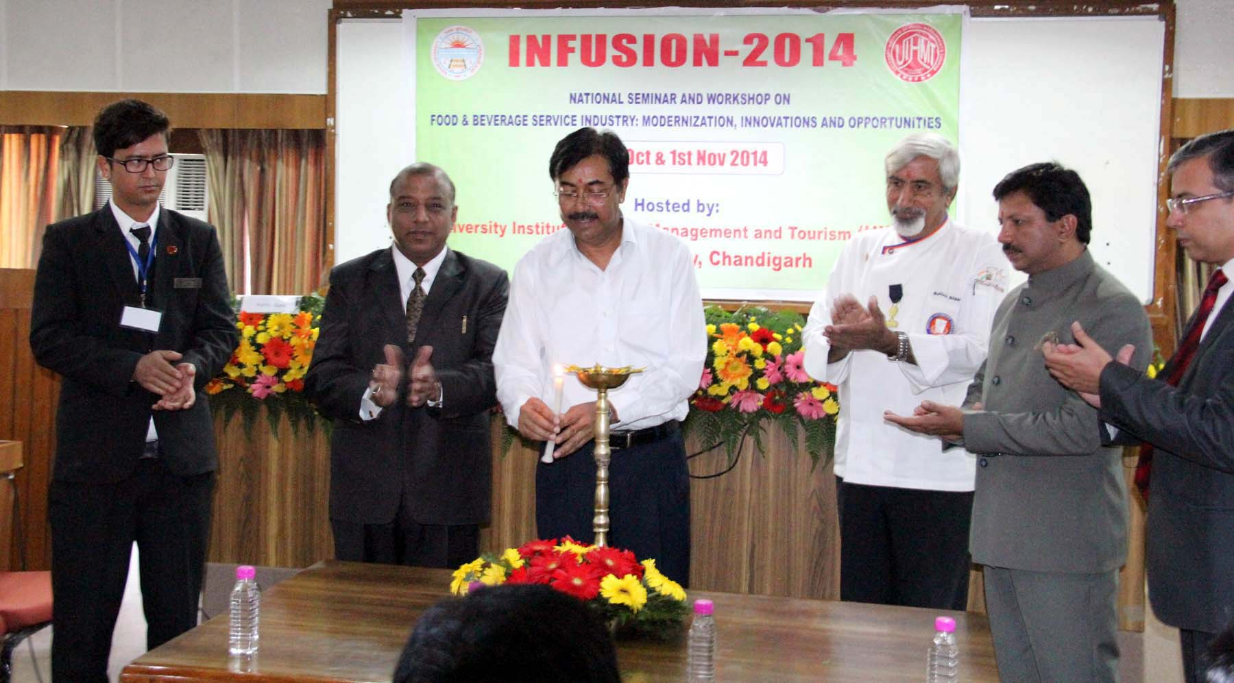 UT Home Secretary, Mr. Anil Kumar lighting the traditional lamp at the inauguration of National Seminar and Workshop on food and beverage service industry- modernization, innovations and opportunities at Panjab University, on Friday, October 31, 2014.