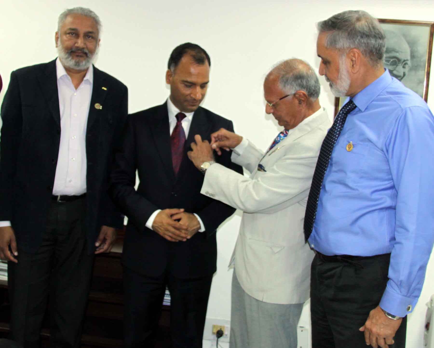 Chairman of the Company of Master Mariners of India, Chandigarh Chapter, Capt. M.S. Kahlon pinning the Merchant Navy Flag on the Lapel of Adviser to the Administrator, UT, Chandigarh, Mr. Vijay Dev, to mark the celebrations of National Maritime Week-2015 at UT Secretariat, Chandigarh on Tuesday, March 31, 2015.