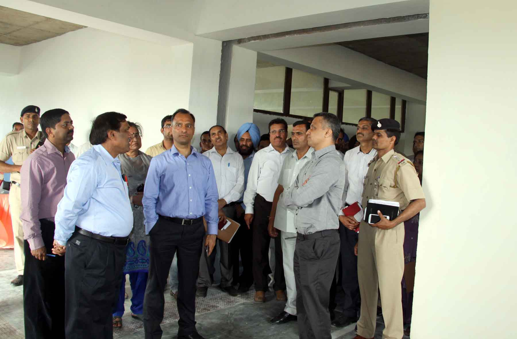 The Adviser to the Administrator, UT, Chandigarh, Mr. Vijay Dev alongwith senior officers of Chandigarh Administration reviewing the progress of ongoing construction work at Govt. College of Commerce and Business Administration, Sector-50, Chandigarh on Friday, April 17, 2015.