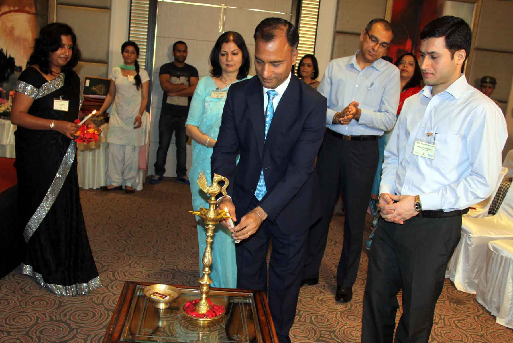 The Adviser to the Administrator, UT, Chandigarh, Mr. Vijay Dev lighting the traditional lamp at the inauguration of �TESOL ACADEMY INDIA-2015� Changing Classrooms, Supporting Teachers at Hotel Park Plaza, Sector-17, Chandigarh on Friday, April 24, 2015.