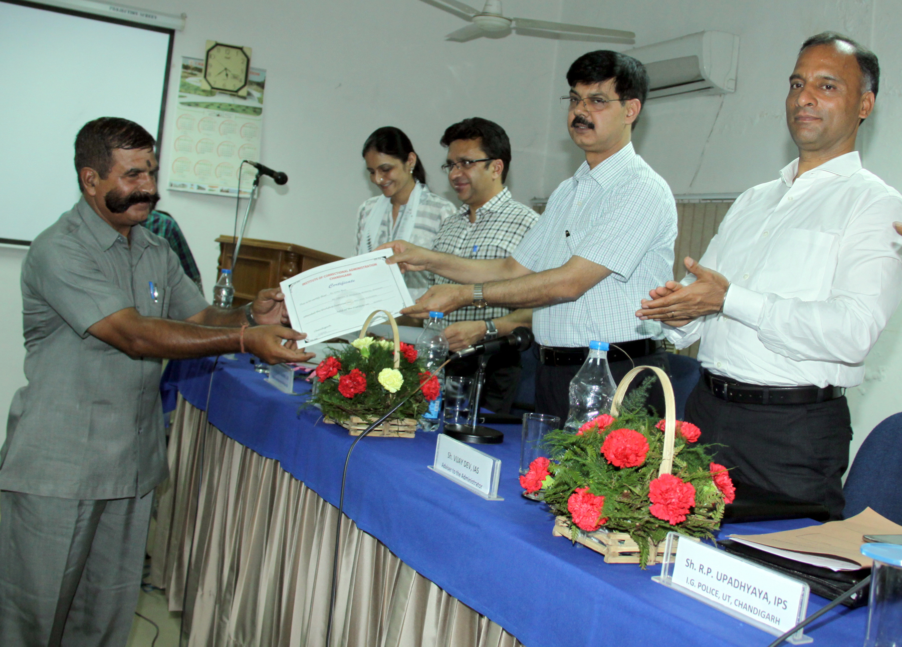 Shri Anant Kumar Singh, IAS, Additional Secretary (CS), Government of India, Ministry of Home Affairs, New Delhi distributing certificates to the participants in the one day workshop on ANTI HUMAN TRAFFICKING at Regional Institute of Correctional Administration at Sector-26, Chandigarh on Friday, July 03, 2015.