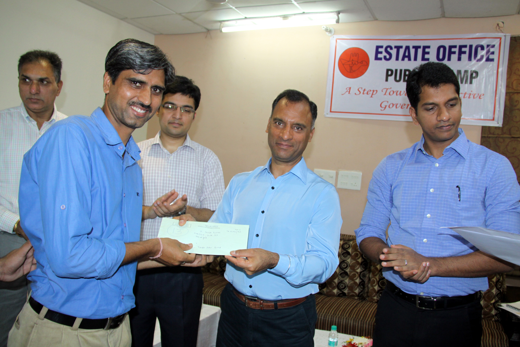 The Adviser to the Administrator, UT, Chandigarh, Mr. Vijay Dev distributing transfer letter to the residents in a Estate Office Public Camp at Rose Club, Sector-16,  Chandigarh on Wednesday, July 29, 2015.