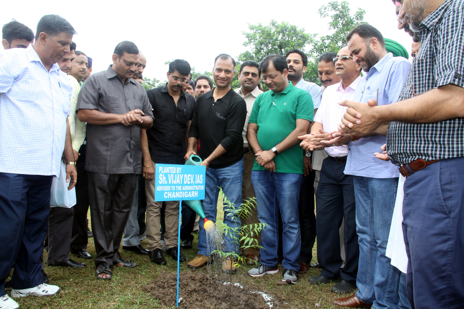 The Adviser to the Administrator, UT, Chandigarh, Mr. Vijay Dev sprinkling water on the sapling of �Neem� in the Park at Sector-48, Chandigarh on Saturday, August 01, 2015.