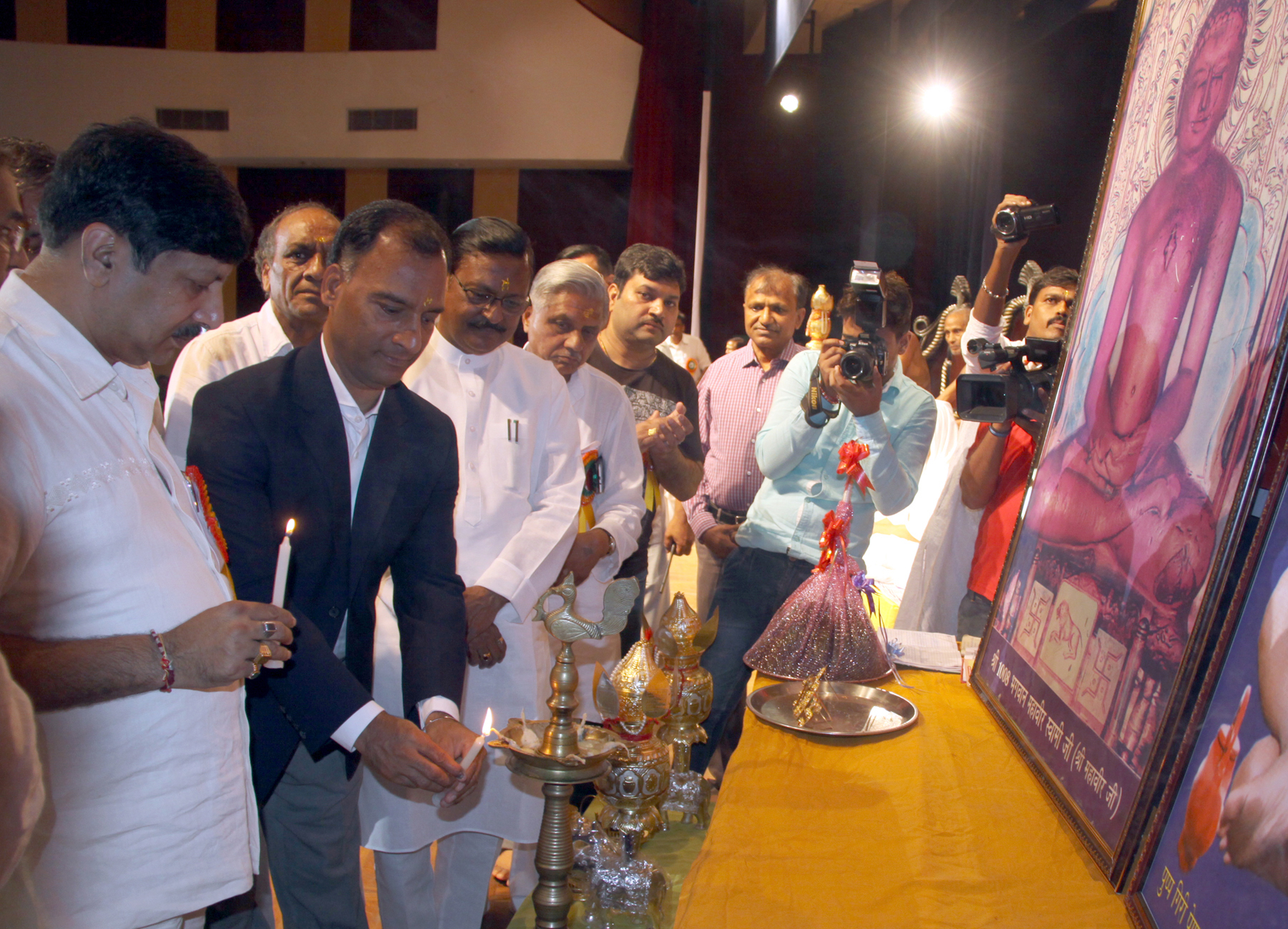 The Adviser to the Administrator, UT, Chandigarh, Mr. Vijay Dev lighting the traditional lamp at the inauguration of Chaturmas Sthapna Diwas at Moti Ram Arya Senior Secondary Model School, Sector-27, Chandigarh on Sunday, August 02, 2015.