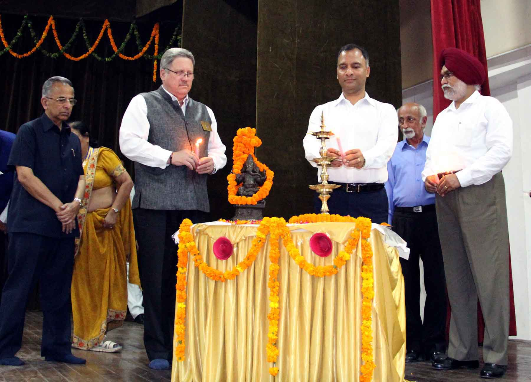 The Adviser to the Administrator, UT, Chandigarh, Mr. Vijay Dev lighting the traditional lamp at the inauguration of Skill Development Programme at Chandigarh College of Engineering and Technology, Sector-26, Chandigarh on Tuesday, September 01, 2015.