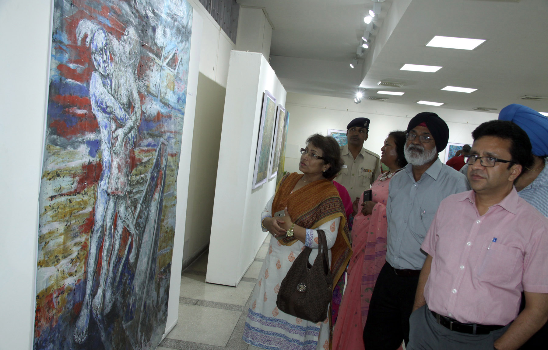 UT Home Secretary, Mr. Anurag Agarwal taking a round of the Exhibition of Paintings by Jagdeep Singh Garcha at Punjab Kala Bhawan, Sector-16, Chandigarh on Friday, April 29, 2016.