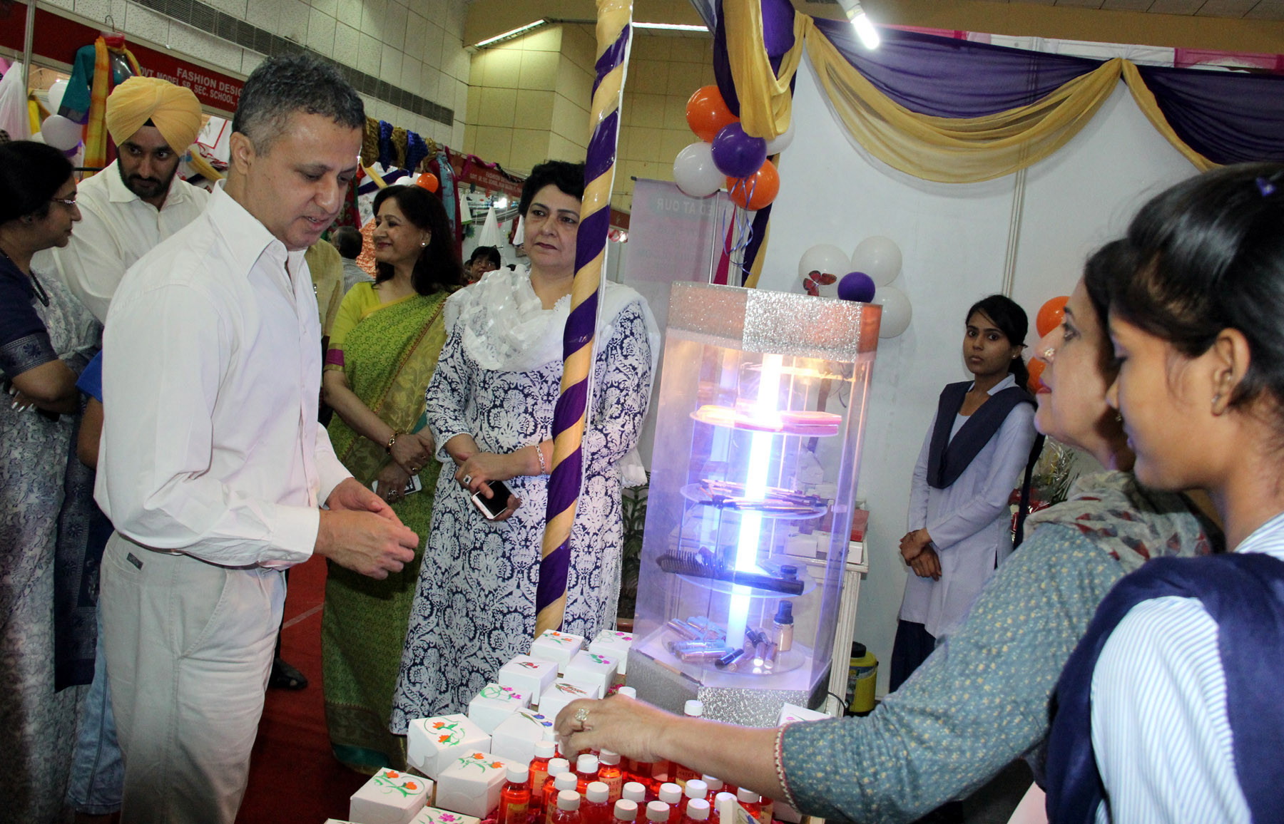 UT Finance-cum-Education  Secretary, Mr. Sarvjit Singh taking a round of the Exhibition-cum-Sale prepared by the 10+2 students of Vocational Courses at Kishan Bhawan, Sector-35, Chandigarh on Friday, May 27, 2016.