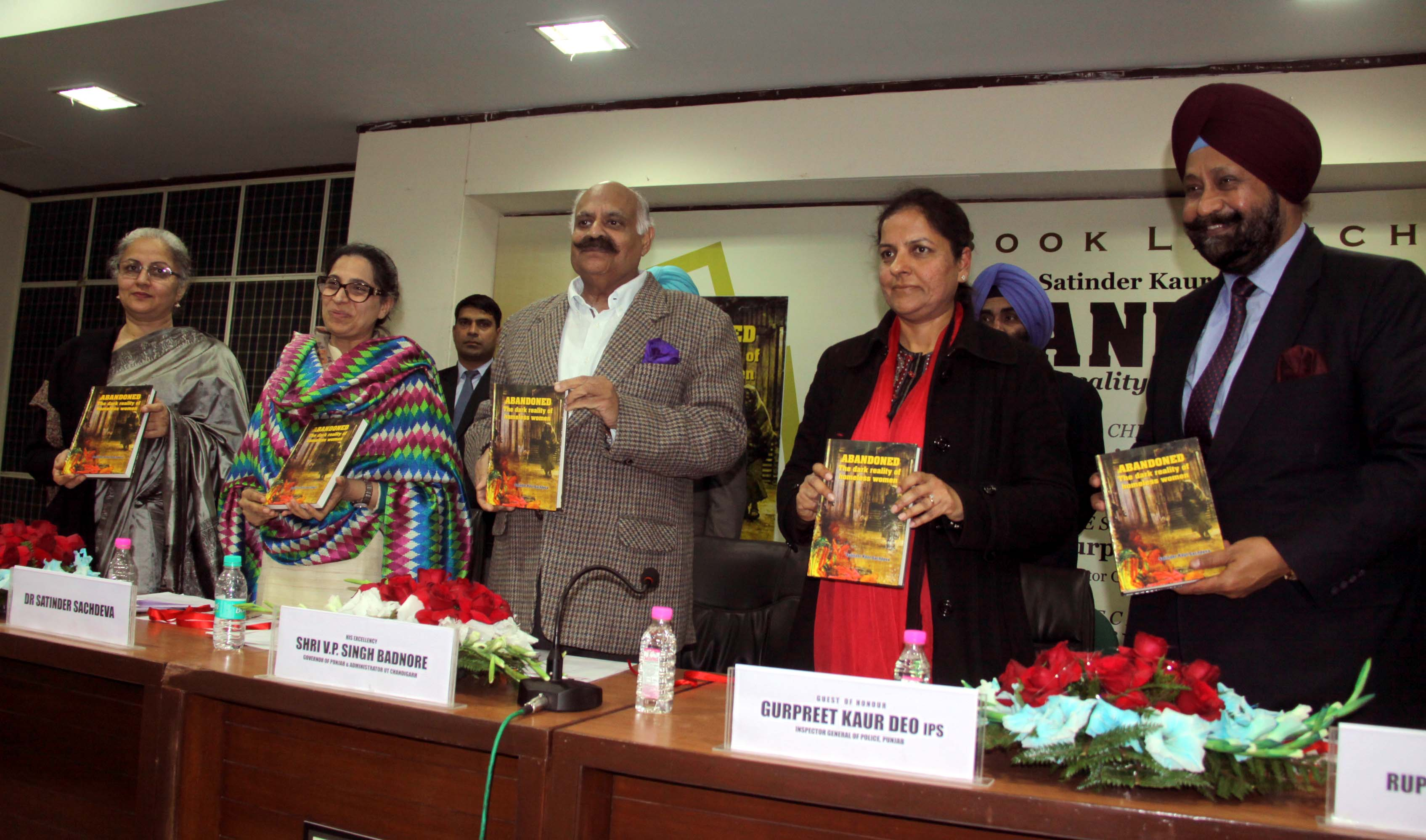 """The Punjab Governor and Administrator, UT, Chandigarh, Shri V.P. Singh Badnore alongwith others officers releasing the book """"ABANDONED"""" the Dark Reality of Homeless Women at PHD House, Sector-31, Chandigarh on Monday, January 23, 2017."""