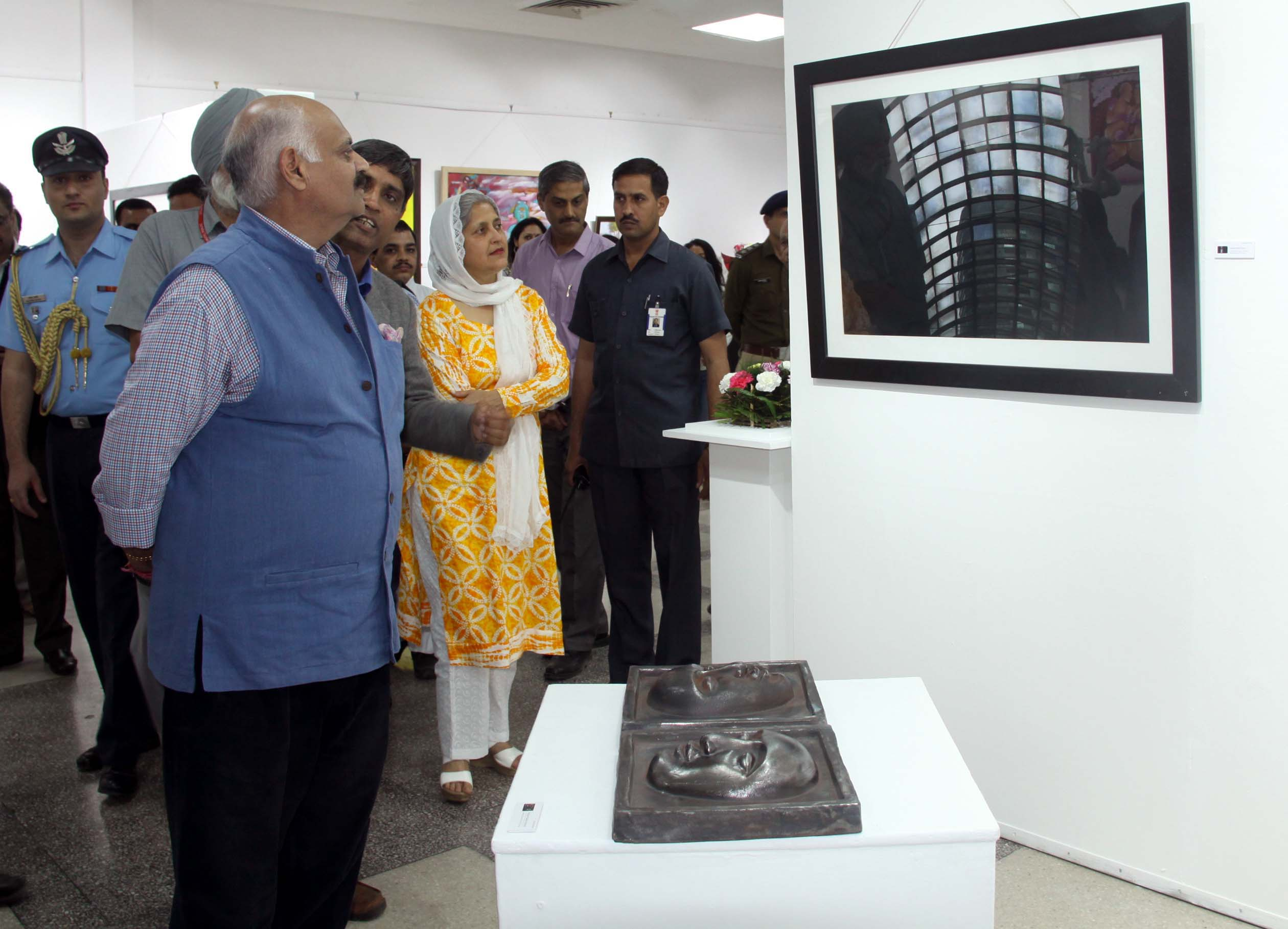 "The Punjab Governor and Administrator, UT, Chandigarh, Shri V.P. Singh Badnore taking a round of the ""Annual Art Exhibition-2016-17"" at Punjab Kala Bhawan, Sector-16, Chandigarh on Wednesday, March 22, 2017."