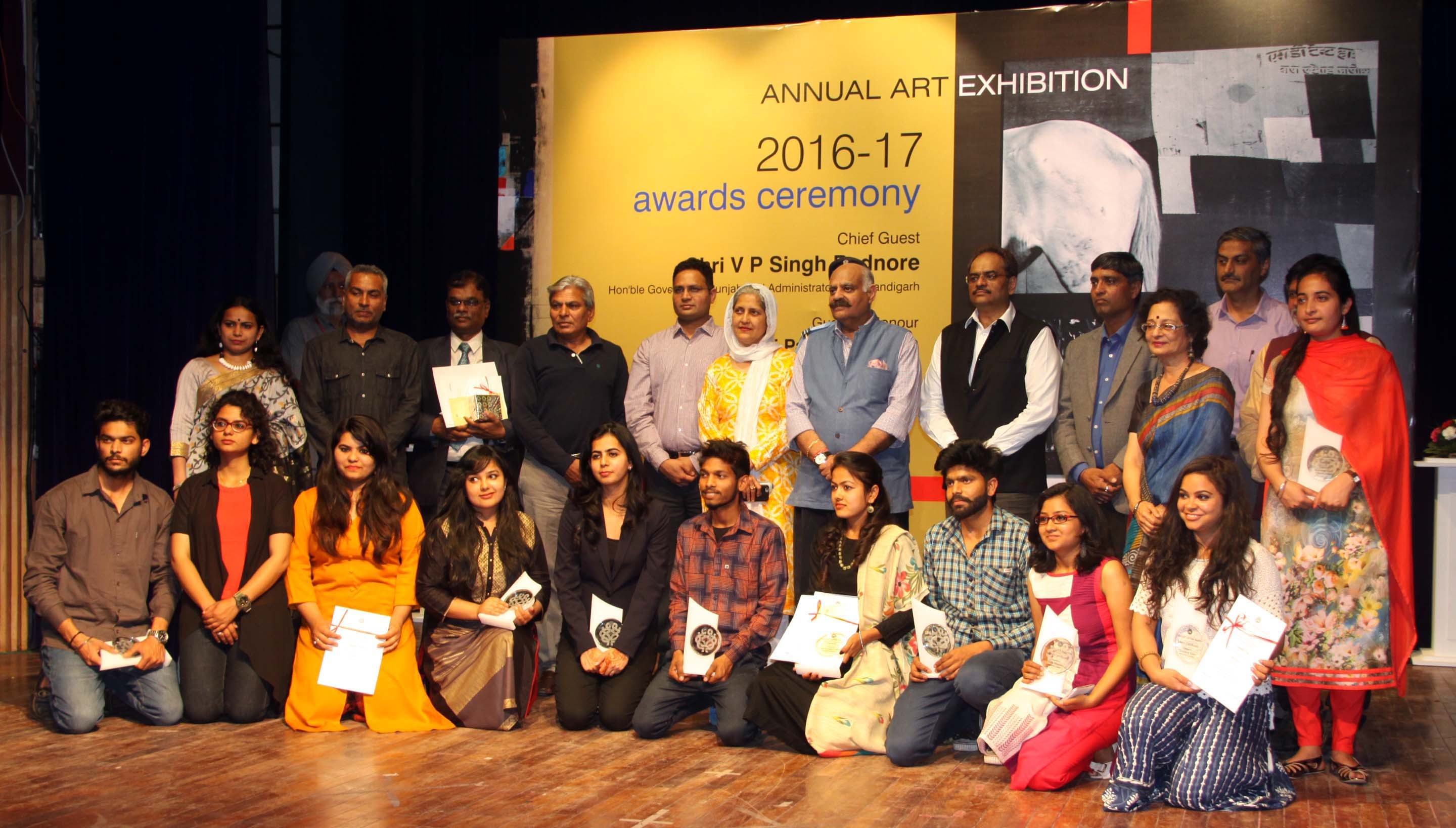 "The Punjab Governor and Administrator, UT, Chandigarh, Shri V.P. Singh Badnore alongwith the Adviser to the Administrator, UT, Chandigarh, Shri Parimal Rai  and senior officers posing with the Awardees of  ""Annual Art Exhibition-2016-17"" at Punjab Kala Bhawan, Sector-16, Chandigarh on Wednesday, March 22, 2017."