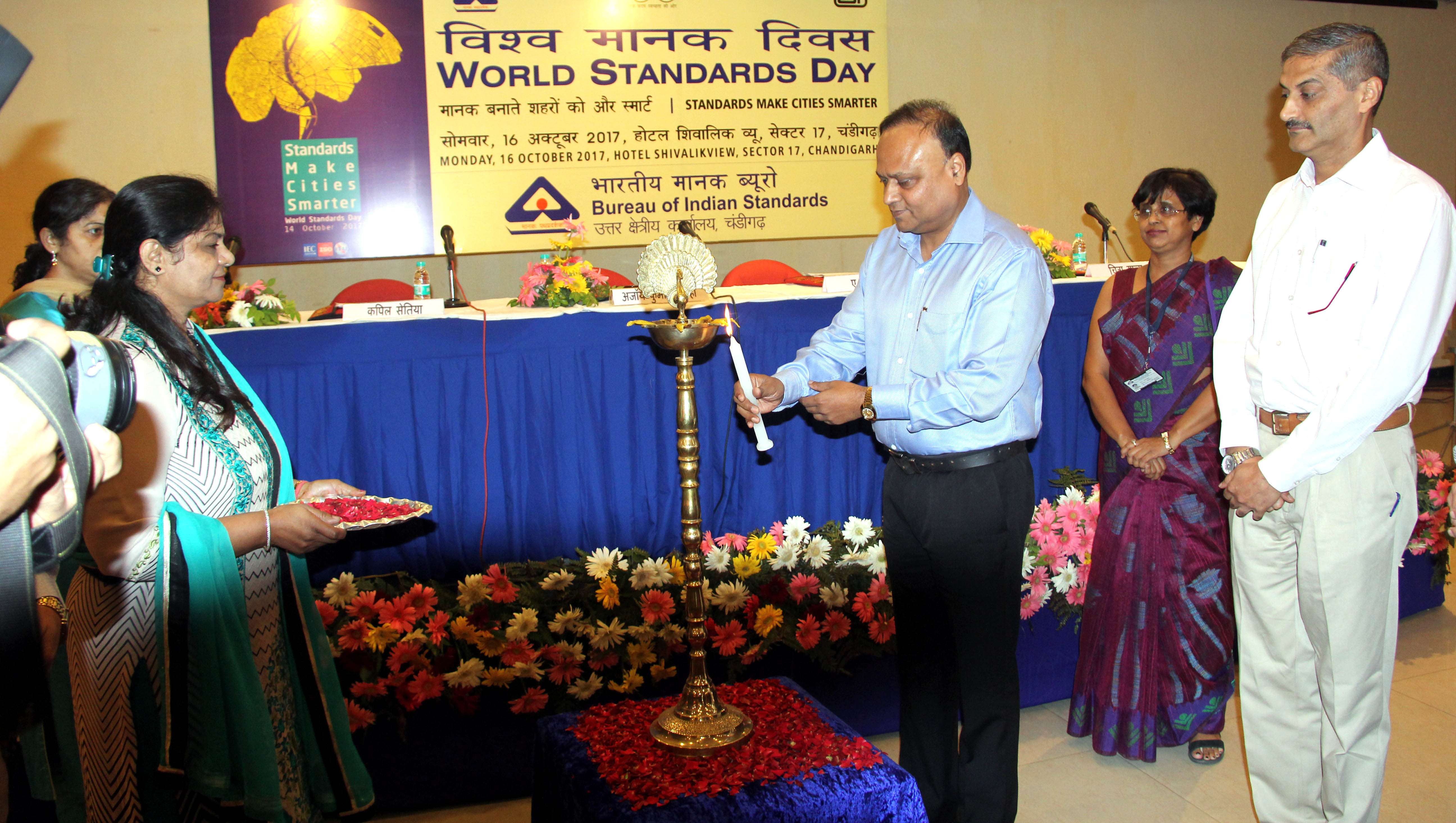 "UT Finance Secretary, Shri Ajoy Kumar Sinha lighting the traditional lamp at the inauguration of ""World Standards Day"" at Hotel Shivalikview, Sector-17, Chandigarh on Monday, October 16, 2017."